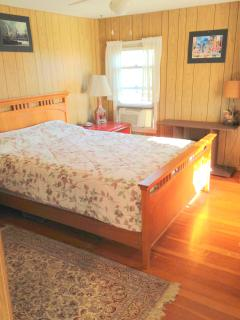 Second Bedroom with queen bed, dresser, air-conditioning, tv and dvd.