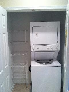 Full sized washer and dryer with extra storage shelves