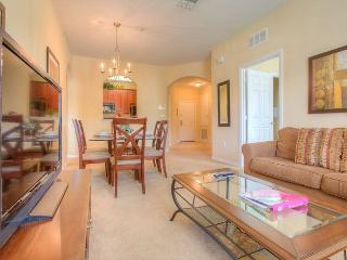 Overlook the flowering courtyard and fountain from this second-floor condo!!!