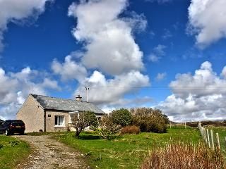 Front of cottage from the main road.Extension to back overlooks hills/loch/moorland.