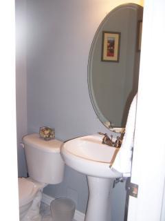 half bathroom next to living room