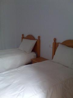 Two single beds in bedroom 2.