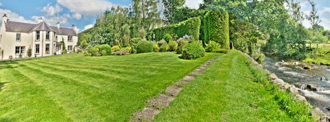 Extensive lawns and stream