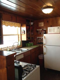 FULLY FURNISHED KITCHEN WITH GAS STOVE, FULL SIZE FRIDGE, MICROWAVE AND EVERYTHING YOU NEED