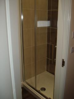Large shower Flat 3, basin on vanity unit, heated towel radiator