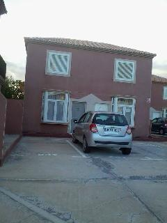 Front of house with parking space