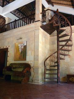 atrium which leads to four double-bedrooms with hand carved wooden doors from Lombok.