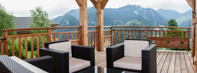 Large terrace with stunning mountain views and plenty of seating to enjoy it all!