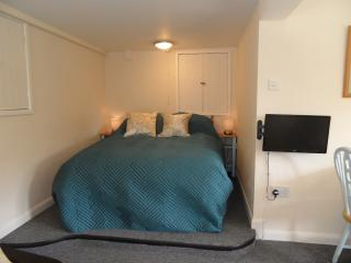 Bed area with bedside tables and touch lamps, TV swings round to watch in bed.