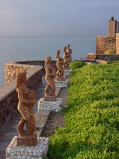 Mermaids keeping watch from the sea wall
