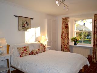 The master bedroom, on the ground floor, comfy king sized bed and en suite shower room