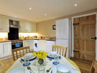 The modern, well equipped kitchen with dishwasher, fridge-freezer and washer-dryer