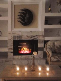Enjoy a romantic evening in this spacious living room by the fireplace.