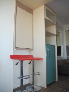 Refrigrator + folded table + two bar-chairs