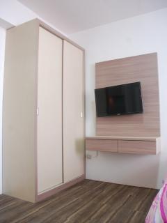 A large cupboard + 32' LED TV