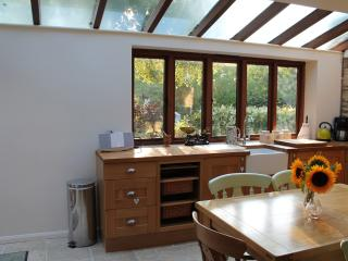 The kitchen;spaceous and light with views over a gorgeous cottage garden