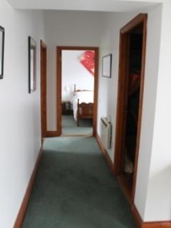Spacious hallway with master en suite bedroom at the end