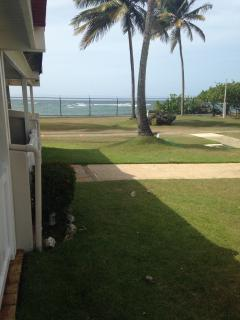View to the Beach from the back Deck in the first level.