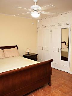The first bedroom offers a queen sized bed and ensuite washroom
