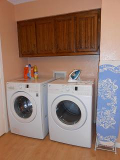 Maytag Washer and Dryer., ironing board and iron.