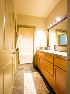 Downstairs - Master  Bath that opens from the 2 twin bedroom or from hallway.  Tub/Shower Combo