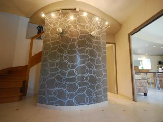 Entrance lobby with curved wall & designer lighting