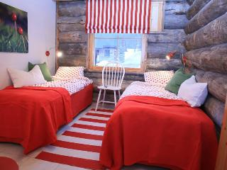 The red Puolukka (Lingonberry) bedroom. Bed can be set as twins or a double bed.
