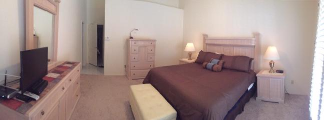 Master Bedroom with King size bed, private en suite double sinks, walk-in closet, flat screen T.V.