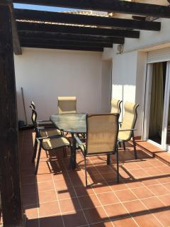 Fabulous terrace with dining table plus two sun loungers to catch the morning sun