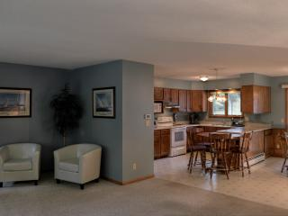 View into open kitchen from living area