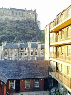 Setting sun shining on Grassmarket Studio, with Edinburgh Castle above
