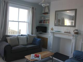 well equipped living room with original cupboards and fireplace and sea views