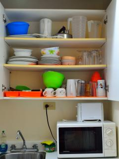 Microwave, Toaster, Electric Kettle, Dishes, Glass and Utensils.