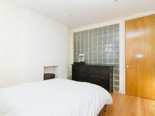Guest bedroom - spacious and clean with dresser and closet for guests to use.