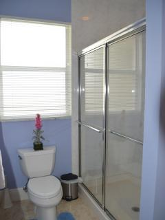 Guest bathroom with large shower.