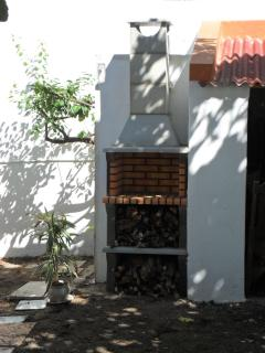 Open fireplace in the garden for you to relax from bustling Lisbon, behind it a shower