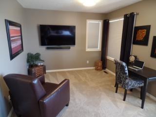 Master bedroom sitting area with 60' Smart TV
