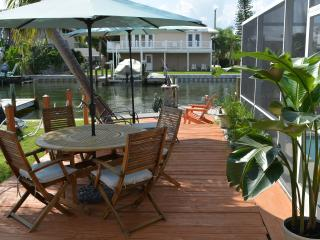 Enjoy lunches and dinners on the deck near the water and pool