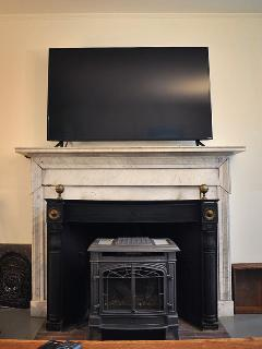 TV room with large comfortable couch, 55 inch HDTV, DVD library and cable