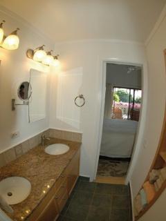 Master en suite with twin sinks in granite counter tops