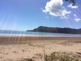 sun rays on Ball Bay beach looking towards Cape Hillsborough
