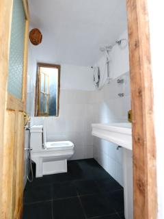 Bathroom with hot water shower.
