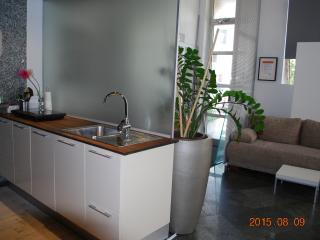 Kitchen with a dishwasher, a microwave and a kettle