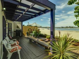 Inviting beachside home w/ bay views & fenced patio! Just steps to the water!