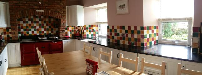 Cosy spacious, sociable kitchen, table seats 12 .