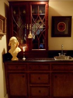 Your own private antique European wetbar accented w/ granite & fine crystal for delicious drinks!