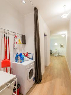 The laundry space: washer-dryer, iron and ironing board.