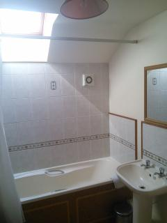 Bathroom with shower and bath screen