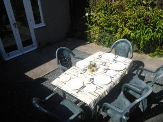 Alfresco dining in sheltered patio area.