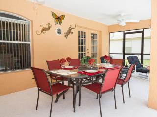 Two side shaded lanai with 8 seater table & chairs, 4 sunbeds and two large ceiling fans